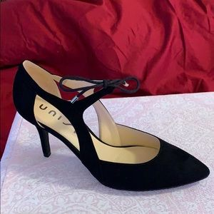 Unusable black suede heel with tie front